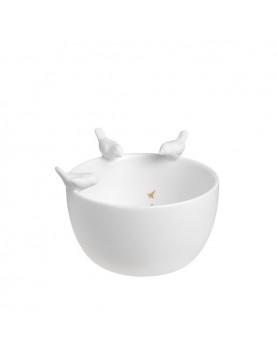 Räder diep schaaltje vogels op rand wit porselein